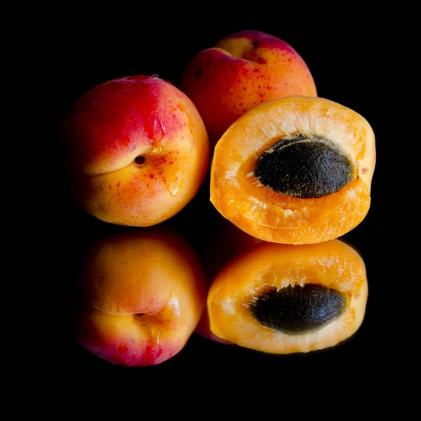 colorful and fresh abricots on black background